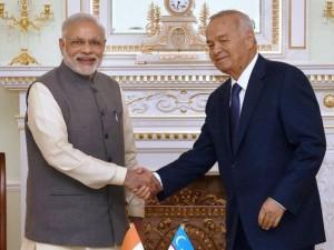 Prime Minister Narendra Modi shakes hands with Uzbekistan's President Islam Karimov during a meeting in Tashkent, Uzbekistan